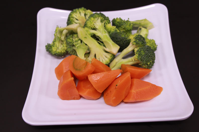 A Plate of broccoli and/or carrot